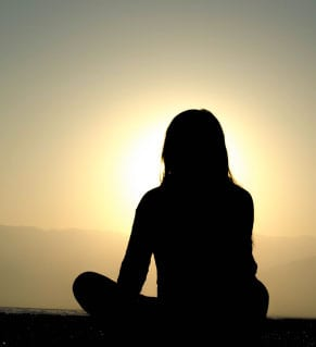 woman-meditating-dusk-counselling-psychology-service